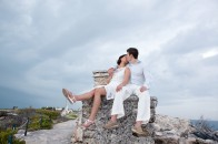 Couple sitting on Mayan ruins