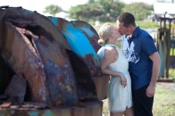Couple leaning and kissing agains blue sculpture