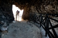 Couple kissing in heart shaped cave